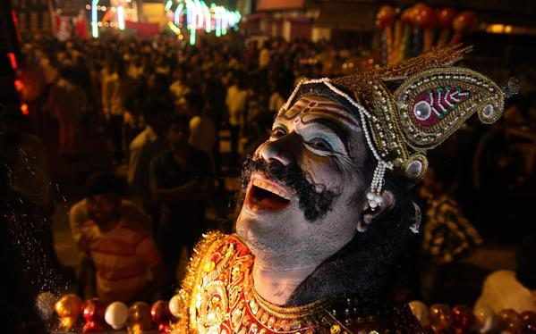 An Indian artist performs during a Dussehra festival procession in Allahabad. The Hindu festival of Dussehra, during which a giant effigy of Ravana is burnt and which celebrates the victory of good over evil, culminates on Wednesday.