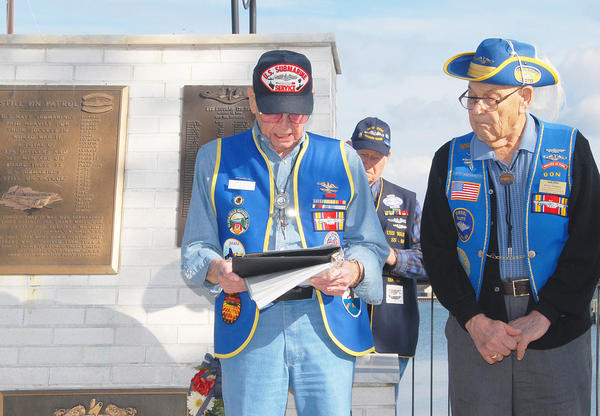 U.S. Submarine Veterans of World War II (from left) Michigan vice-commander Calvin Space, of Grand Ledge, Ed Feury, of Hartford and Michigan commander Don Morell, of Muskegan, read the names of 52 U.S. Submarines lost during World War II, during an observance in Charlevoix, Saturday. U.S. Navy submariners and well wishers gathered at the memorial of the U.S.S. Escolar in Charlevoix¿s East Park, Saturday for a remembrance service. A total of 52 submarines and 3,606 men were lost in action during World War II representing the highest mortality rate (22 percent) of any branch of the service.