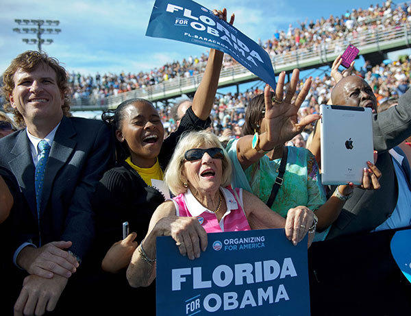 "Supporters cheer as US President Barack Obama speaks during a campaign rally at the Delray Beach Tennis Club, October 23, 2012 in Delray Beach, Florida. Barack Obama and Mitt Romney took their head-to-head battle for the US presidency to key swing states Tuesday after a feisty but inconclusive final debate. Post debate polling showed Obama winning Monday night's faceoff but analysts said Romney, who adopted more dovish-sounding foreign policy prescriptions that differed little from the president's, may have been helped by the encounter. ""The fact that Mr Romney was able to show himself to not be the dangerous, wild conservative that Obama has been trying to portray him as, that may help him,"" said Christopher Arterton, a political science professor at George Washington University."