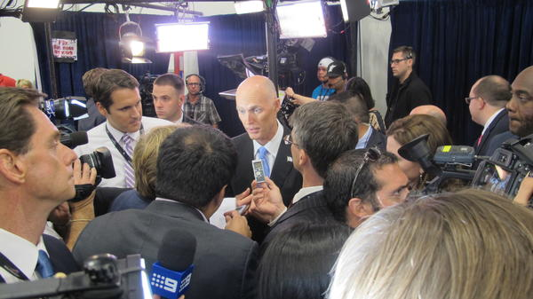 Florida Gov. Rick Scott, a Republican, busy talking to journalists at the Boca presidential debate