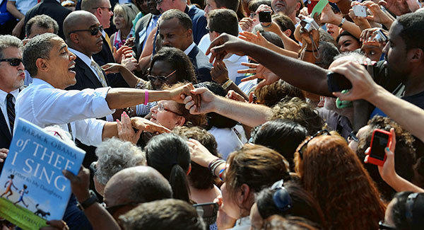 President Barack Obama greets supporters at a campaign event in Delray Beach Tuesday morning. Several thousand supporters filled the Delray Beach Tennis Center to hear the President speak at what the campaign called a Grassroots Event.
