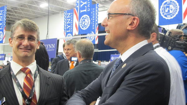 At the debate in Boca Raton, U.S. Rep. Ted Deutch talks to a reporter.