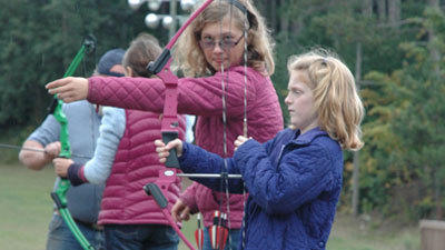 Children are instructed how to shoot bows and arrows during a YMCA youth archery course in Petoskey. Instructor Dale Arnott believes the sport is another option for kids who arent involved in physical sports, either for lack of interest or physical ability.