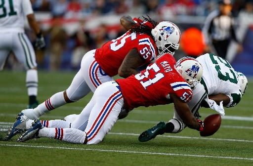 Kecoughtan High graduate Jerod Mayo (51) and Patriots teammate Brandon Spikes force Jets running back Shonn Greene to fumble Oct. 21.