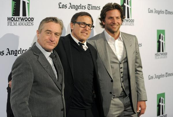 "Robert De Niro, left, director David O. Russell and Bradley Cooper won honors for ""Silver Linings Playbook"" at Monday night's Hollywood Film Awards."