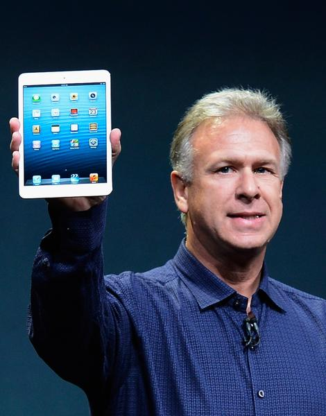 Apple Inc. marketing chief Phil Schiller displays the new iPad Mini to reporters as the new device in unveiled in San Jose