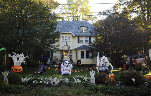 The Erickson home in Catonsville is covered in lights and props for Halloween.