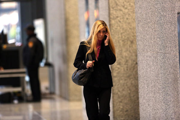 Karolina Obrycka, who was beaten by former Chicago Police Officer Anthony Abbate, walks through the lobby of the Dirksen U.S. Courthouse during a break in the trial against Abbate.