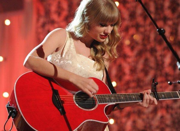 "Taylor Swift's new album, ""Red,"" posted strong sales on its first day of release."