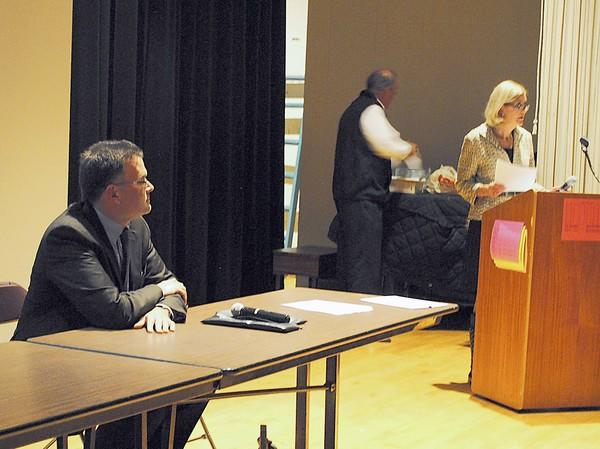 Joe Adams, left, is introduced by Winnetka Caucus Village Candidates Committee Chairwoman Susan Harris at the Oct. 18 Caucus Council meeting, moments after members failed to approve original choice Patrick Livney to run for the position.