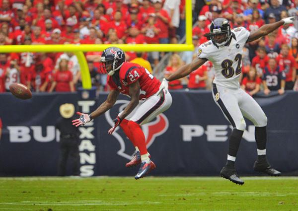 Texans cornerback Johnathan Joseph intercepts a pass by Joe Flacco intended for Torrey Smith.