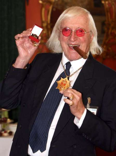 For decades, Jimmy Savile, shown here in 2008, was a fixture on British television, an eccentric, aggressively jocular host of children's shows and a tireless charity fundraiser. A year after he died at 84 and honored as Sir Jimmy, several women have come forward to claim he was also a sexual predator and serial abuser of underage girls.