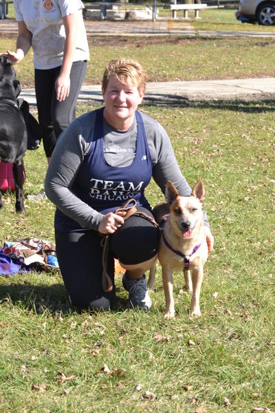 "Jen Walker of South Holland and Lucy, a cattle dog mix rescued from Louisiana during Hurricane Isaac earlier this year. Lucy was found tied to an outdoor fence with a sign that read ""We don't want her anymore"" before a rescue group took her in."