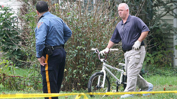 Police remove a bicycle from a home near where 12-year-old Autumn Pasquale's body was found in a recycling bin.