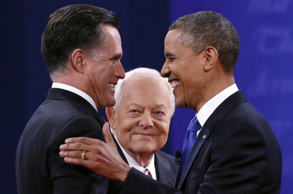 President Barack Obama (R) and Republican presidential nominee Mitt Romney shake hands at the start of the final presidential debate at Lynn University in Boca Raton, Florida October 22, 2012. At center is moderator Bob Schieffer.