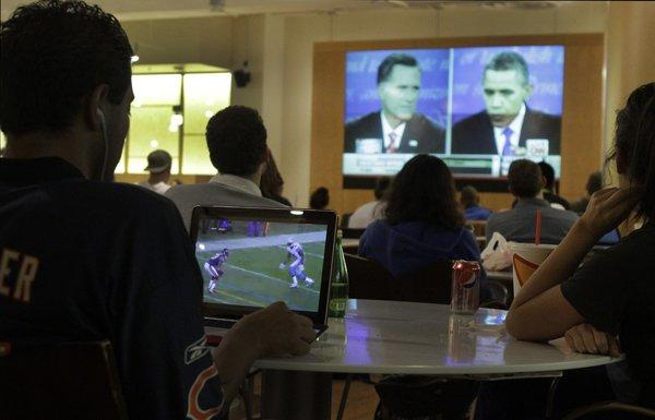 Students at UCLA's Ackerman Student Union watch the last presidential debate. This year's general election presidential debates have drawn bigger audiences than those in 2008.