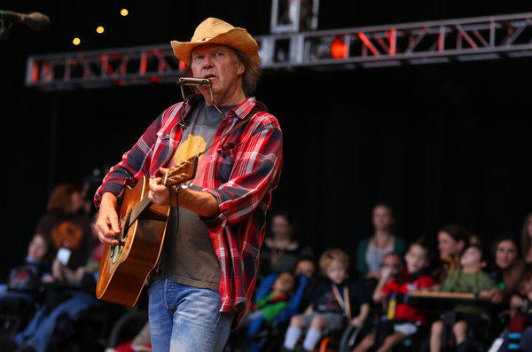 Neil Young, at the 2012 Bridge School Benefit in Northern California, will respond to fans' questions on Twitter on Oct. 24.