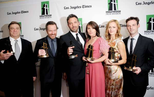 Actors John Goodman, Bryan Cranston, Ben Affleck, Clea DuVall, Kerry Bishe and Scoot McNairy, winners of the Hollywood Ensemble Cast Award, pose during the 16th Annual Hollywood Film Awards Gala presented by The Los Angeles Times held at The Beverly Hilton Hotel.
