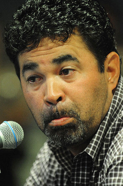 Miami Marlins Manager Ozzie Guillen listens to a question during a news conference, Tuesday, April, 10, 2012, at Marlins Park in Miami. Guillen apologized for his remarks about Fidel Castro.