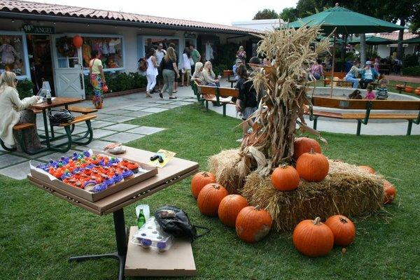 Shoppers stroll through seasonally decorated courtyard at Malibu Country Mart, which will host special Halloween activities Oct. 31.
