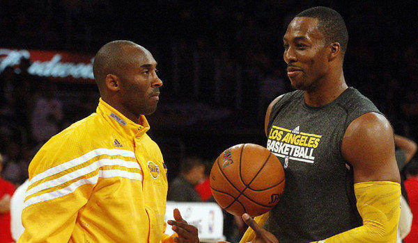 Lakers superstars Kobe Bryant, left, and Dwight Howard chat before a preseason game against the Sacramento Kings on Sunday.