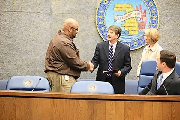 Orland Township election judge Timothy Smith shakes hands with Cook County Clerk David Orr during a ceremony honoring standout election judges this month.