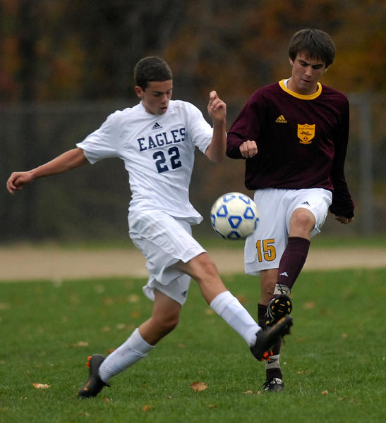 South Windsor's, Jeffrey Allen, 15, and East Catholic's Luke Schroeder, 22, battle for the ball in the second half.