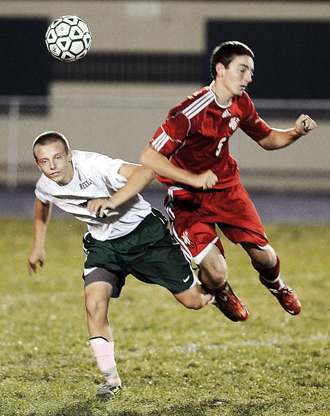 South Hagerstown's Austin Johnson and North Hagerstown's Garrett Singer collide after going for the header in the first half of Tuesday night's MVAL Antietam game at School Stadium.