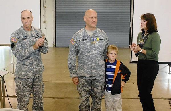 Maj. Robert Hornberger (center), of Nazareth, received the Soldiers Medal and Pennsylvania Cross of Valor in a ceremony at Harrisburg Military Post Saturday. He was recognized for his actions to free a trapped motorist from a burning van in Luzerne County Dec. 21. Brig. Gen. John Gronski (left), 28th Infantry Division commander, presented the medals. Hornberger was joined by his son, Gabriel, 5, and his wife, Linda.