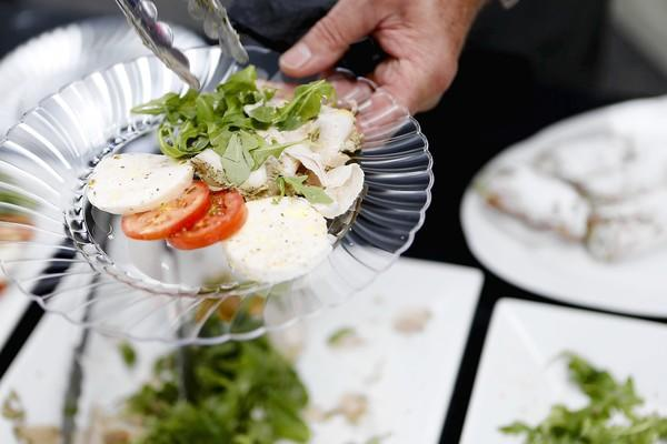 The Porchetta alla Romana (cq) and the Imported Mozzarella di Bufala (cq) served by Tocco's owner and chef Bruno Abate (cq) during an unveiling celebration at Terminal 5 at Chicago O'Hare International Airport seen here on Tuesday, Oct. 16, 2012.