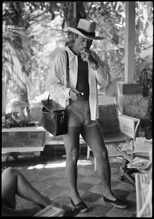 "Phil Stern's photo of John Wayne in Acapulco in 1959 is one of 21 art photos that will make up the ""American Icons"" show on the grassy commons at the Americana at Brand mall in Glendale. Gallery owner Daniel Miller said he wants to bring shows to where people congregate rather than waiting for them to walk in his door."