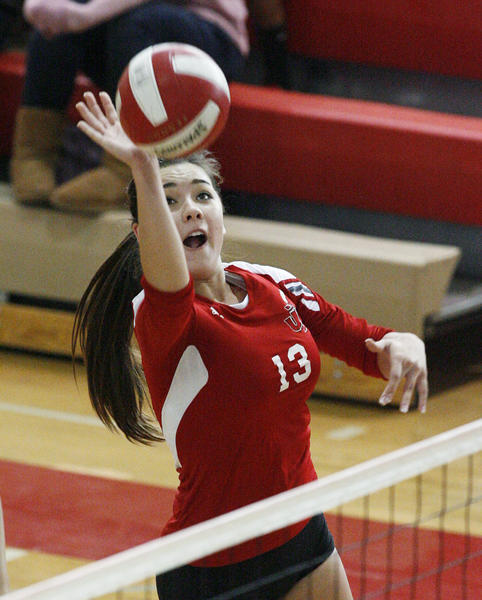 Burroughs' Caitlin Cottrell tips the ball in a Pacific League girls volleyball match against Arcadia at Burroughs High School in Burbank on Tuesday, October 23, 2012.