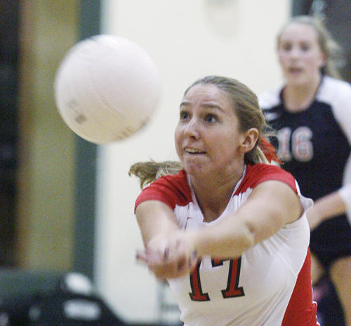 Flintridge Sacred Heart's Colleen Degnan, off a tipped block, dives to bump the ball into play against Louisville in a Mission League girls volleyball match at FSHA in La Canada Flintridge on Tuesday, October 23, 2012.