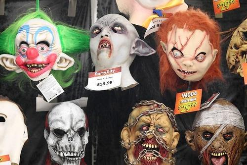 Halloween masks stare back at customers at Party City in Anneslie.