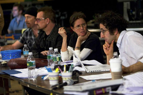 "Glen Berger, right, working with Julie Taymor on the Broadway musical ""Spider-Man: Turn Off the Dark"" in 2009 alongside Bono and the Edge, who wrote the score."