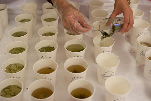 A hostess prepares green tea inside the lobby of the Great Hall of the People during the National People's Cogress (NPC) in Beijing.