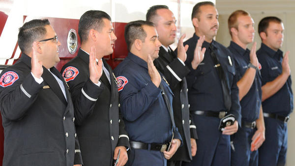 "Calexico firefighters Esteban Zambrano, Juan Contreras, Eduardo ""Lalo"" Rivera, George Villanueva and Oscar Pesquiera take their oaths as they are promoted to engineers while newly hired firefighters Kevin Lewis and Steven Palmieri also take their oaths Tuesday."
