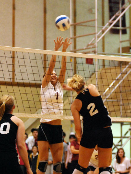 Harbor Light Christian junior Katie Walker (left) attempts to block an attack from Ellsworth senior Kari Steenwyk during Tuesday's Northern Lakes Conference match at Harbor Light Christian.