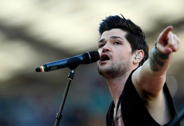 The Script's Danny O'Donoghue performs before the Melbourne Storm-Canterbury Bulldogs at ANZ Stadium Sept. 30, 2012 in Sydney, Australia