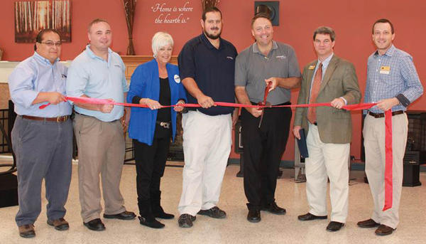 Cutting a ribbon at ThompsonGas' new retail showroom at 6708 Old National Pike in Boonsboro on Sept. 29 are, from left, Joe Jardeleza, ThompsonGas showroom manager; Jeremy Miley, ThompsonGas account sales; Ann Kastle, ThompsonGas account sales/ service representative; Steve Ingram, ThompsonGas service manager; Doug MacMaster, ThompsonGas regional vice president; Brien Poffenberger, president of the Hagerstown-Washington County Chamber of Commerce; and Jason Shank, Hagerstown-Washington County Chamber of Commerce.