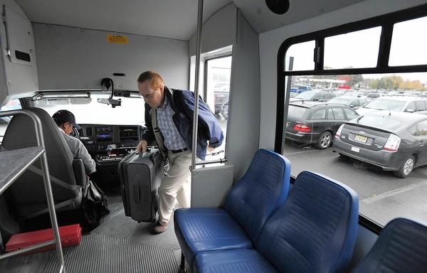 Airport Terminal Shuttle driver Luis Dutan, who drives a 10 min loop to pick up passengers from economy parking to the main terminal, picks up frequent business flyer BIll Koehler, of Saylorsburg. Faced with declining passengers and high debt, Lehigh Valley International Airport will be laying off workers and cutting cut back services to balance its 2013 budget.