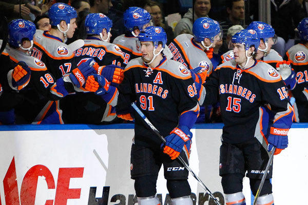 New York Islanders center John Tavares (91) and right wing P.A. Parenteau (15) celebrate with teammates after scoring a goal during the second period against the Boston Bruins at Nassau Veterans Memorial Coliseum.