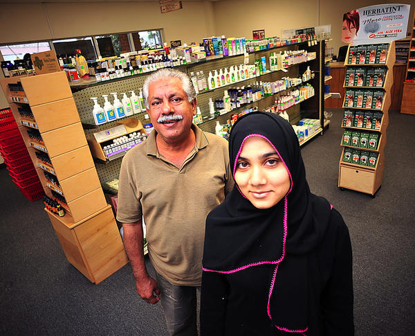 Healthy Lifestyle Natural Foods Manager Tariq Anwar, front, and owner Benish M. Pirzada stand inside the new store at 222 E. Oak Ridge Drive, Hagerstown, in the South Pointe Shopping Center. Pirzada also recently opened College Mini Mart at 11341 Robinwood Drive in Hagerstown.
