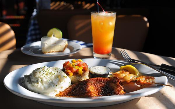 Pictured are the Marlin's Sizzle with blackened tilapia, jumbo skewered shrimps & crab cake, and homemade key lime pie.