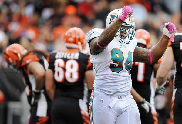 Dolphins defensive end Randy Starks celebrates as the Bengals hang their heads after kicker Mike Nugent missed a late fourth quarter field goal.