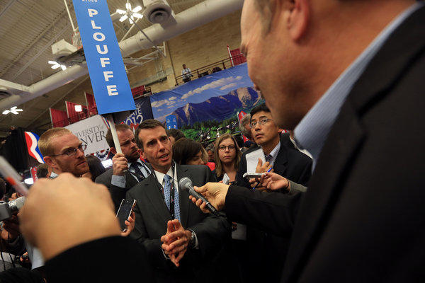 White House senior advisor David Plouffe talks to reporters after the first presidential debate in Denver.