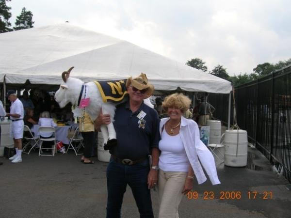 Ronald Carlberg, with his wife, Jo, and the missing goat mascot.