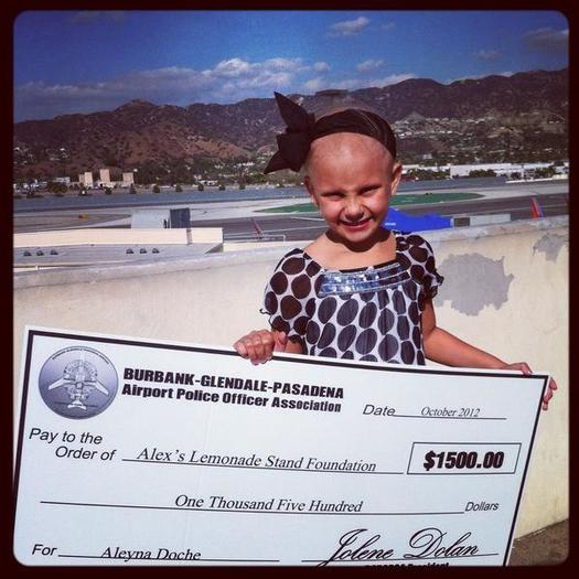 Six-year-old Aleyna Doche holds her donation check on Tuesday, Oct. 23, 2012.