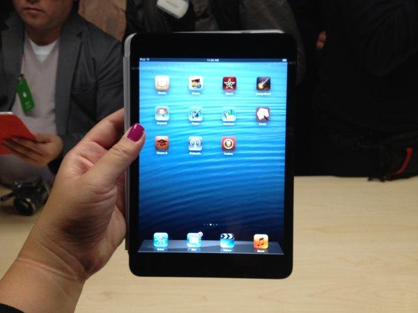 Holding the iPad mini at Apple's invitation-only media event in San Jose on Tuesday.
