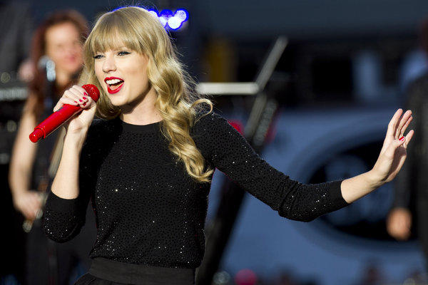 "Taylor Swift, performing in Times Square for ""Good Morning America,"" has released the video for her song ""Begin Again."""